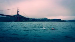 A swimmer in front of the Golden Gate Bridge, San Francisco